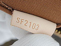 d88976c52e47 Date Code embossed on a leather tag sewn to the lining of a Louis Vuitton  handbag.