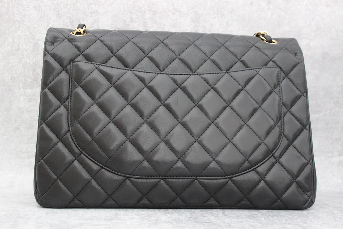 3d14090b4f7e Chanel Black Quilted Lambskin Classic Maxi Single Flap Bag. Tap to expand