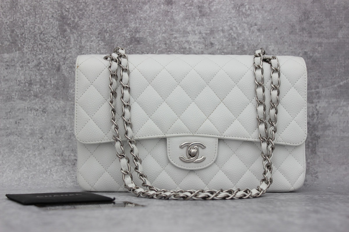 198d8db84e1a ... Classic Flap Bag. Previous Next. Chanel White Caviar 10. Tap to expand