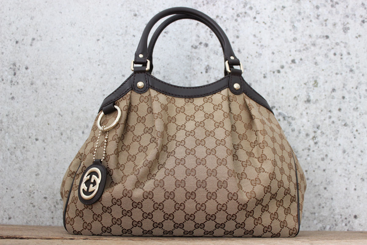 f015b5d47b21 Gucci Sukey Medium GG Canvas Tote. Tap to expand