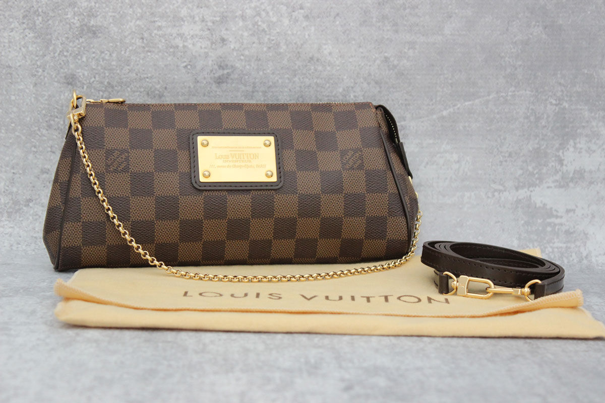 b3d40c8a8e0c Louis Vuitton Damier Ebene Eva Clutch at Jill s Consignment