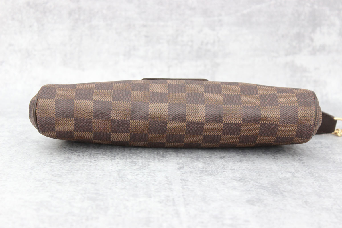 d564ae29a15e Louis Vuitton Damier Ebene Eva Clutch at Jill s Consignment