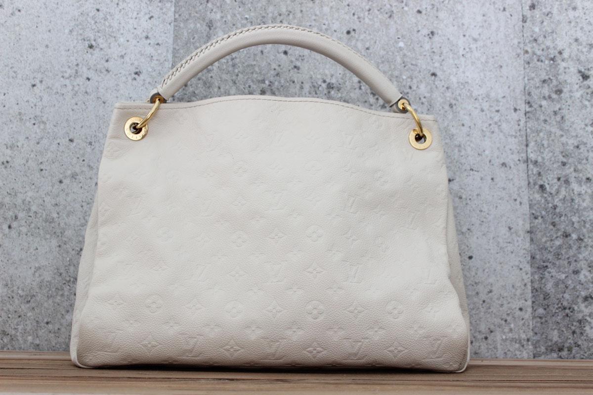 11f042c5c578 Louis Vuitton Monogram Empreinte ARTSY MM Neige. Tap to expand