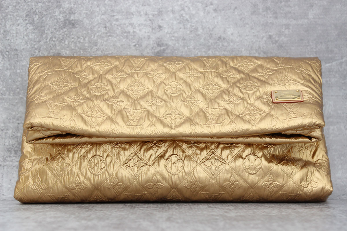 0c431963544c Louis Vuitton Gold Limelight MM Clutch at Jill s Consignment