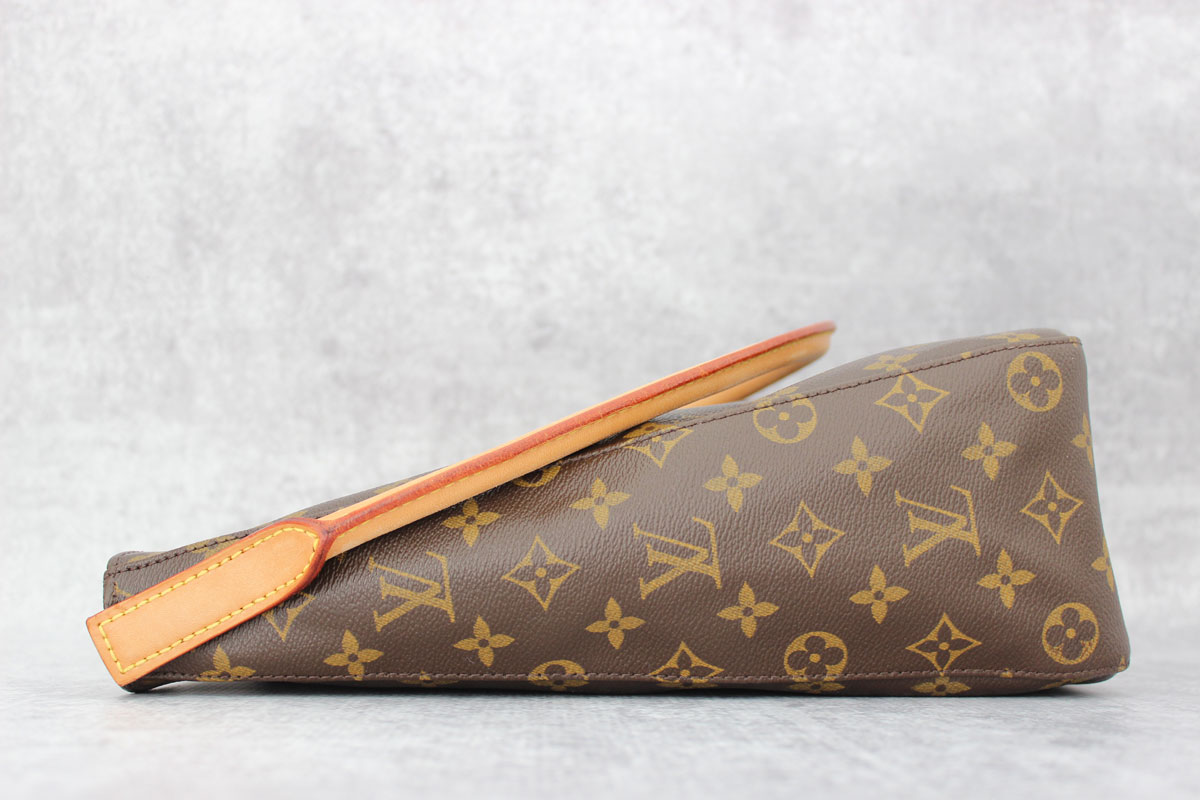 ae921f61593ed Louis Vuitton Monogram Canvas Looping GM. Tap to expand