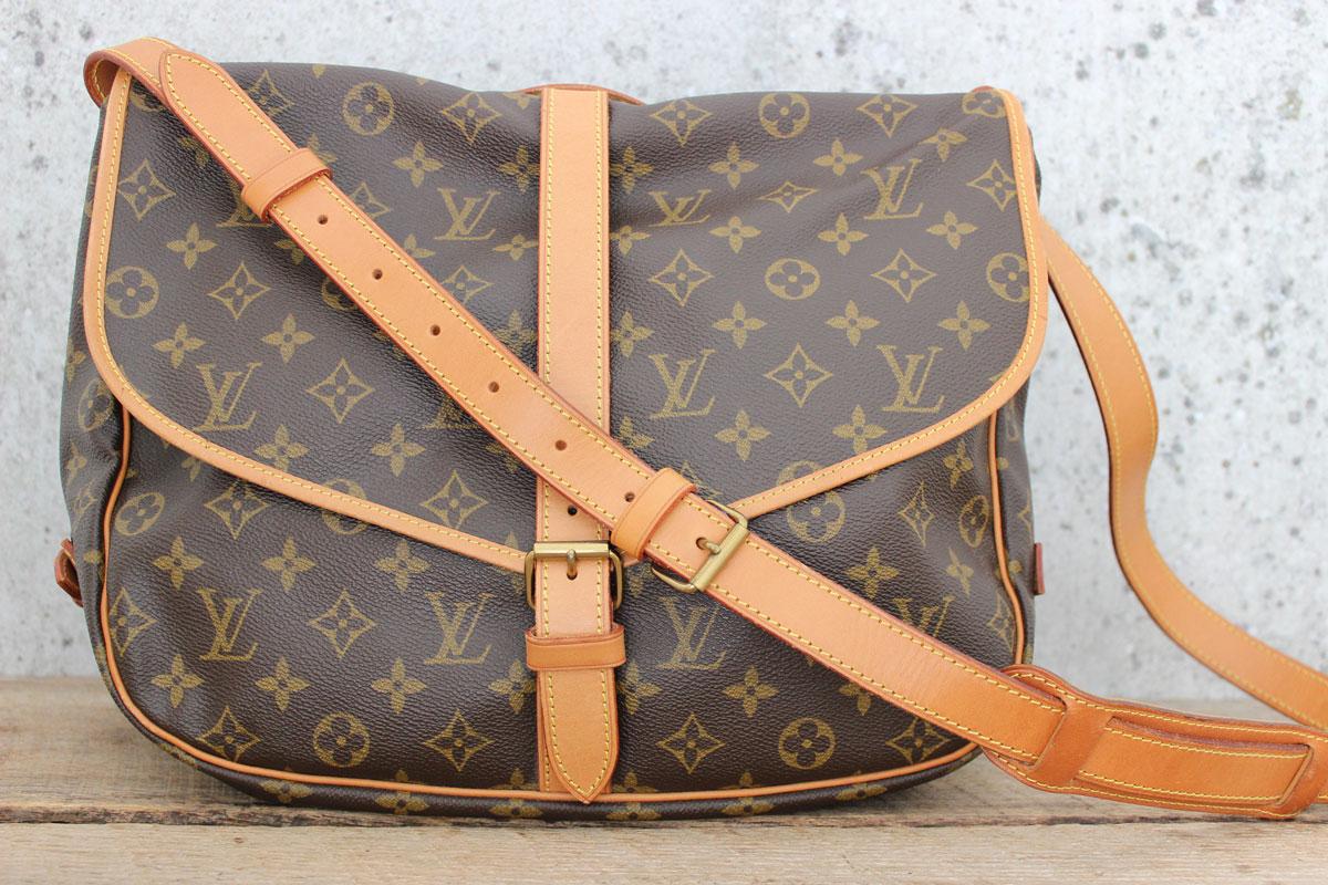 85b927df1eff Louis Vuitton Monogram Canvas SAUMUR 35 Bag. Tap to expand
