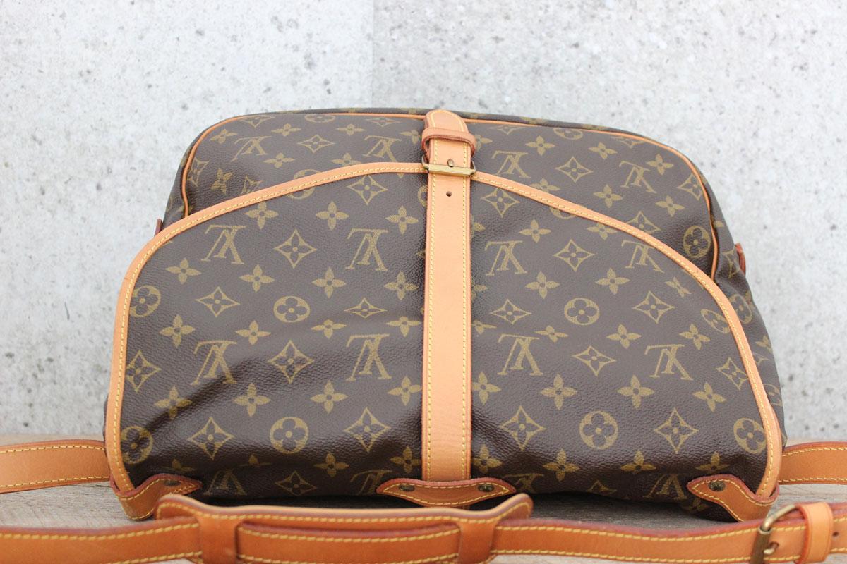 7f232f3f4a13f Louis Vuitton Monogram Canvas SAUMUR 35 Bag. Tap to expand