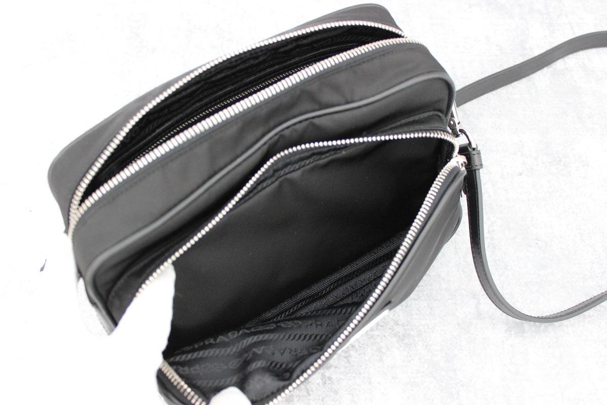 296945401 Prada black nylon & leather crossbody camera bag at Jill's Consignment