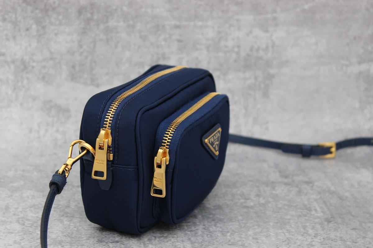 7d1cebd6c5e Prada Tessuto Small Pocket Crossbody Bag with Wrist Strap