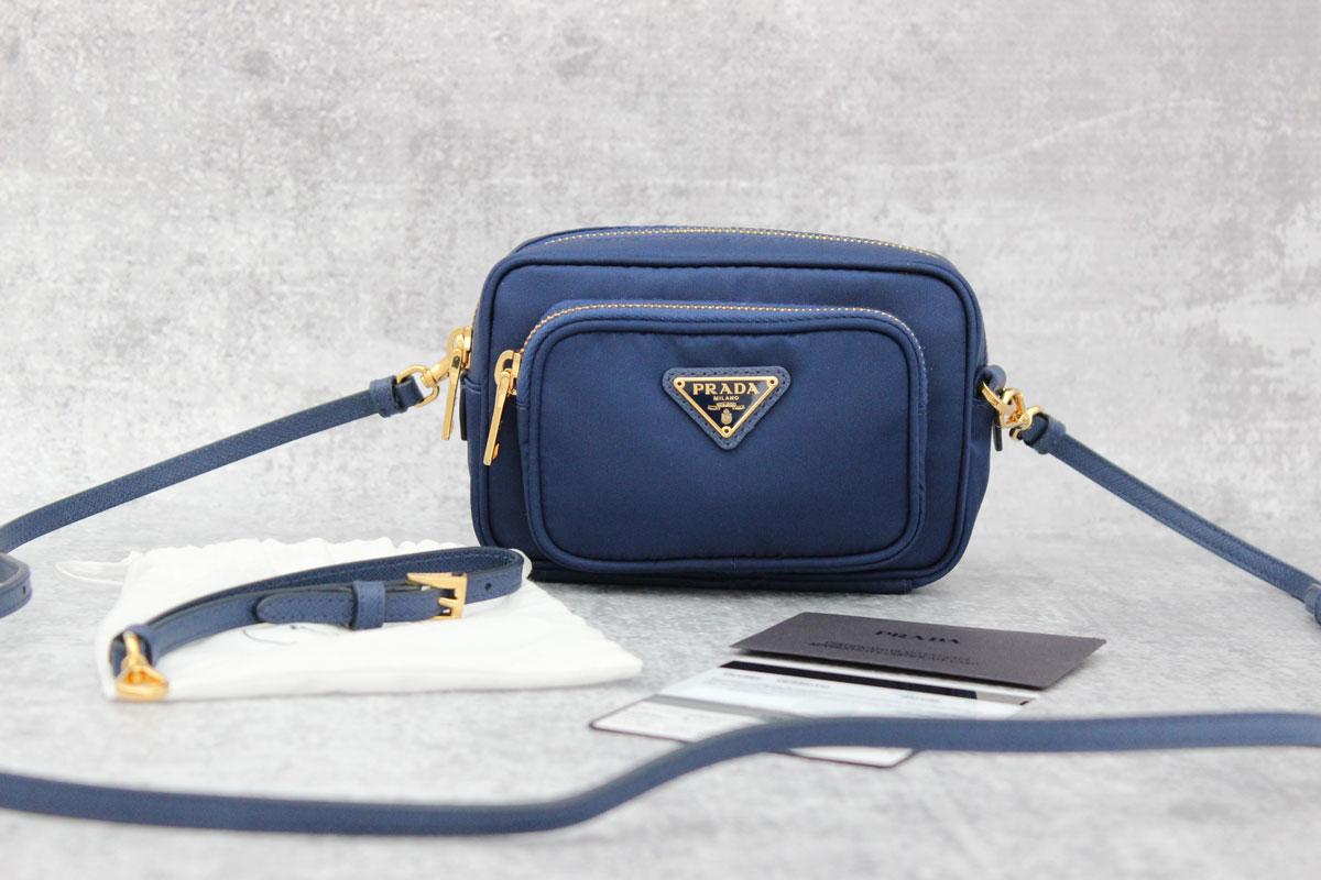 e2407d1a8008 Prada Tessuto Small Pocket Crossbody Bag with Wrist Strap. Tap to expand
